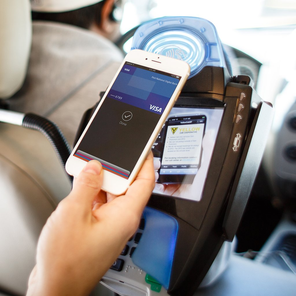 Person using mobile app to pay in a cab