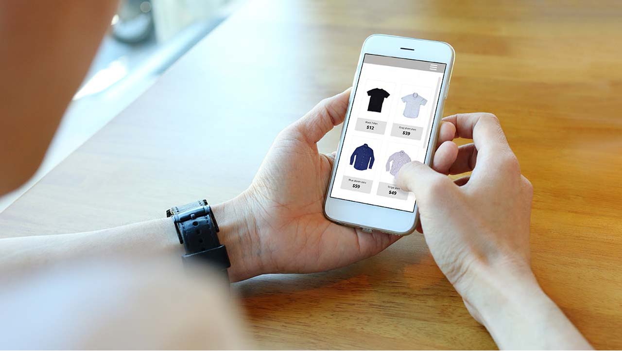 Person using mobile phone to select an item for purchase.
